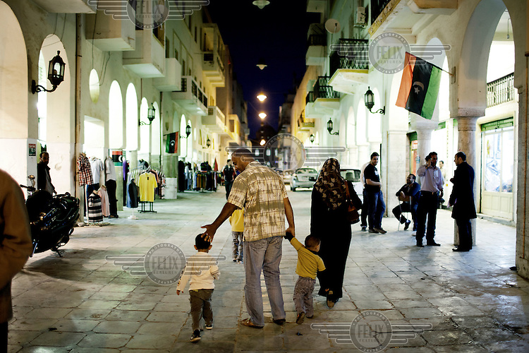 A family stroll down a street in the old part of Benghazi. Life is slowly returning to normal in this city. On 17 February 2011 Libya saw the beginnings of a revolution against the 41 year regime of Col Muammar Gaddafi..