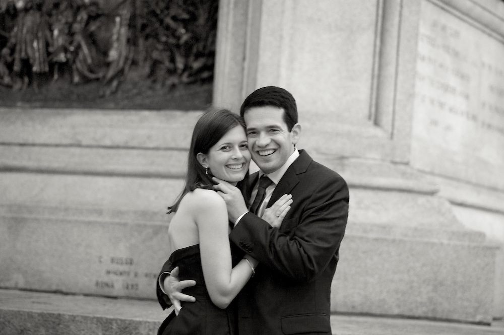 Black & white sepia toned engagement portrait of happy couple.