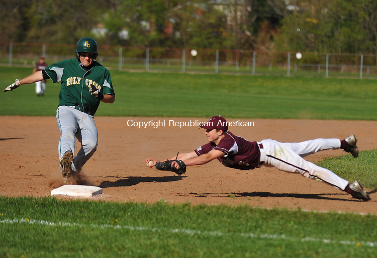 WATERBURY, CT-23 APRIL 2010-042310IP02- Holy Cross's Aaron McCulloch avoids a tag at third base by Naugatuck's Zack Mercer during their game at Holy Cross High School in Waterbury on Friday.<br /> Irena Pastorello Republican-American