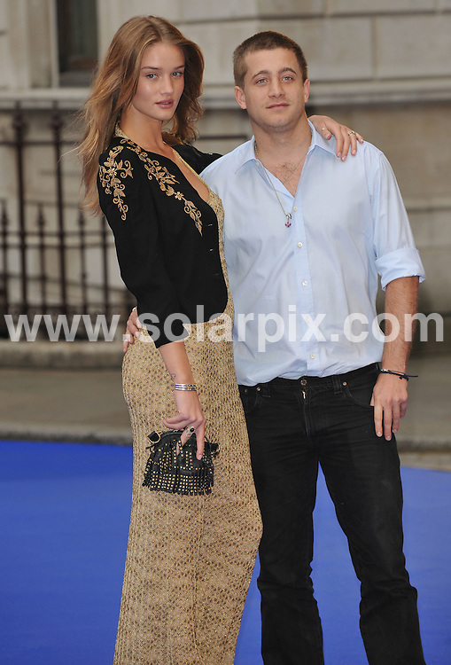 **ALL ROUND PICTURES FROM SOLARPIX.COM**.**WORLDWIDE SYNDICATION RIGHTS**.Royal Academy of Art Summer Exhibition 2009, London, UK. 3 June 2009..This pic: Rosie Huntingdon Whiteley and Tyrone Wood..JOB REF: 9148 SSD     DATE: 03_06_2009.**MUST CREDIT SOLARPIX.COM OR DOUBLE FEE WILL BE CHARGED**.**ONLINE USAGE FEE GBP 50.00 PER PICTURE - NOTIFICATION OF USAGE TO PHOTO @ SOLARPIX.COM**.**CALL SOLARPIX : +34 952 811 768 or LOW RATE FROM UK 0844 617 7637**