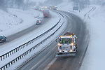Pix: Shaun Flannery/shaunflanneryphotography.com...COPYRIGHT PICTURE>>SHAUN FLANNERY>01302-570814>>07778315553>>..1st December 2010...........Snowfall in the United Kingdom, December 2010..A snow plough clears a lane on the south bound carriageway as traffic struggles along the A1 Doncaster bypass in South Yorkshire, United Kingdom.