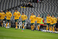 MELBOURNE, AUSTRALIA - OCTOBER 14: Members of the Australian soccer team warming up for an AFC Asian Cup 2011 match between Australia and Oman at Etihad Stadium on October 14, 2009 in Melbourne, Australia. Photo Sydney Low www.syd-low.com