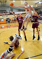 Westside Eagle Observer/MIKE ECKELS<br /> <br /> Kaleb Furlow (15) snatches a Lions rebound away from Cole Criscom (Wolves 45) during the first quarter of the Gravette-Lincoln varsity basketball game at the Competition Gym Dec. 3.