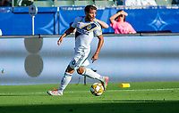 CARSON, CA - SEPTEMBER 29: Jonathan dos Santos #8 of the Los Angeles Galaxy looks for an open man during a game between Vancouver Whitecaps and Los Angeles Galaxy at Dignity Health Sports Park on September 29, 2019 in Carson, California.