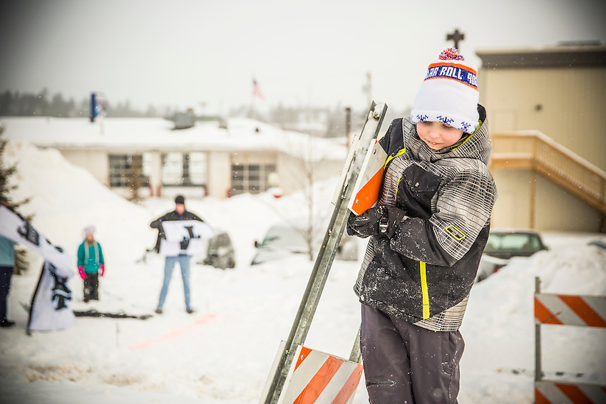 Volunteers help at the 906 Polar Roll winter fat bike race in Marquette, Michigan.