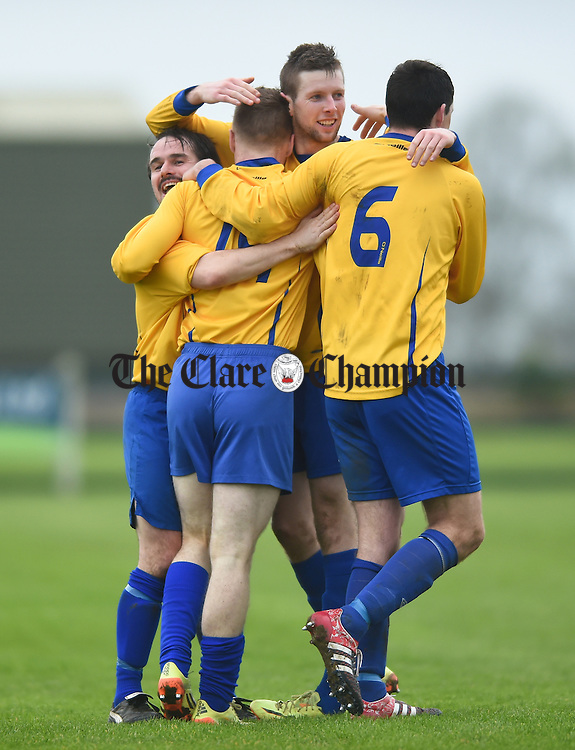 Joe Collins of Clare (14) celebrates his goal against Limerick with team mates Daryl Eade, Colin Smyth and Stephen Kelly during their FAI Oscar Traynor game in Limerick. Photograph by John Kelly.