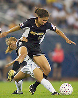 Shannon Boxx of the Power tangles with Homare Sawa of the Beat. The Atlanta Beat and the NY Power played to a 1-1 tie on 7/26/03 at Mitchel Athletic Complex, Uniondale, NY..