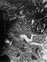 Atrocity committed by the Japs on 9 April 1945 at Bingas, Luzon, Philippine Islands.  Child laying in mud of creek.  April 11, 1945.  T5c. J. Jepson.  (Army)<br /> NARA FILE #:  111-SC-212513<br /> WAR &amp; CONFLICT BOOK #:  1251