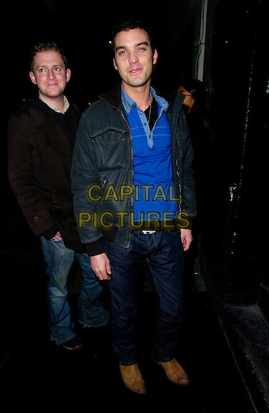JAKE MASKELL & GUEST.The Gene Simmons Family Jewels Party, Kabaret's Prophecy Club, London, UK..January 18th, 2007.full length black jacket blue top jeans denim .CAP/CAN.©Can Nguyen/Capital Pictures