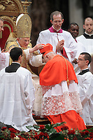 Italian newly appointed Cardinal Francesco Monterisi (R) gets his biretta, the square red hat symbolising the blood of the martyrs, from Pope Benedict XVI (L) on November 20, 2010 during a consistory at St Peter's basilica at The Vatican. 24 Roman Catholic prelates join today the Vatican's College of Cardinals, the elite body that advises the pontiff and elects his successor upon his death