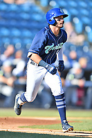 Asheville Tourists Cade Harris (4) runs to first base during a game against the Columbia Fireflies at McCormick Field on June 22, 2019 in Asheville, North Carolina. The Tourists defeated the Fireflies 6-5. (Tony Farlow/Four Seam Images)