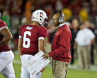 STANFORD, CA - August 31, 2012: Stanford quarterback and head coach Josh Nunes (6) and David Shaw during the Stanford Cardinal vs San Jose St. Spartans at Stanford Stadium in Stanford, CA. Final score Stanford Cardinal 20, San Jose St 17.