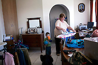 KLEINFONTEIN, SOUTH AFRICA - JULY 15: Annatjie Oncke irons clothes as she works as a domestic worker for a big family with children on July 15, 2013 in Kleinfontein outside Pretoria, South Africa. The all white town with about one thousand residents are all Afrikaners with a Vortrekker heritage. Only white Afrikaners who share Afrikaner culture, language and religion are allowed to settle in the town.  (Photo by: Per-Anders Pettersson)
