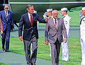 United States President George H.W. Bush, left, and President Mikhail Gorbachev of the Union of Soviet Socialist Republics, right, in conversation as they arrive for day of talks at Camp David, the presidential retreat near Thurmont, Maryland on Saturday, June 2, 1990.  From left to right, President Bush, first lady Barbara Bush, Raisa Gorbachev, unidentified interpreter, and President Gorbachev.<br /> Credit: Ron Sachs / CNP