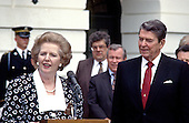 Washington, DC - (FILE) -- Prime Minister Margaret Thatcher of the United Kingdom, left, makes remarks after visiting United States President Ronald Reagan, right, at the White House in Washington, D.C. on Friday, July 17, 1987. .Credit: Howard L. Sachs - CNP
