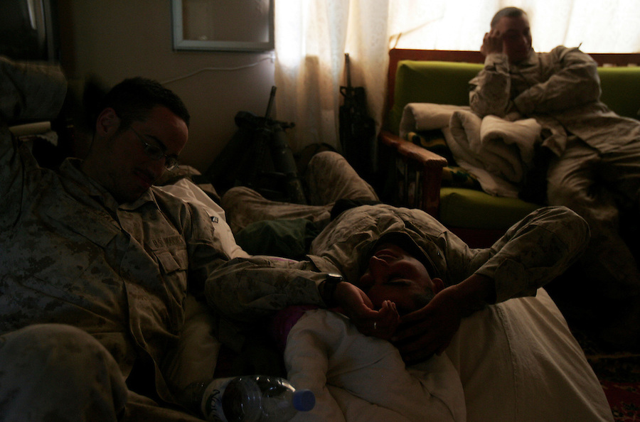 US Marines relax in a commandeered home in Ubaydi during Operation Steel Curtain on Tues. Nov. 15, 2005.