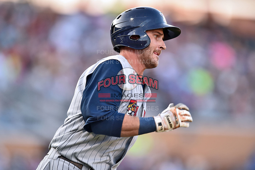 Toledo Mud Hens second baseman Brandon Douglas #11 runs to first base during a game against the Durham Bulls at Durham Bulls Athletic Park on July 25, 2014 in Durham, North Carolina. The Mud Hens defeated the Bulls 5-3. (Tony Farlow/Four Seam Images)