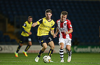 Dan Crowley of Oxford United under pressure from Matt Jay of Exeter City during the The Checkatrade Trophy match between Oxford United and Exeter City at the Kassam Stadium, Oxford, England on 30 August 2016. Photo by Andy Rowland / PRiME Media Images.