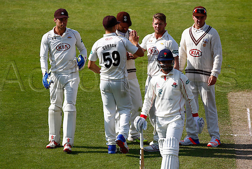 23.05.2016. Old Trafford, Manchester, England. Supersavers County Championship. Lancashire versus Surrey.  Surrey bowler Stuart Meaker celebrates with his team mates after he dismisses Lancashire batsman Alviro Petersen for 105.