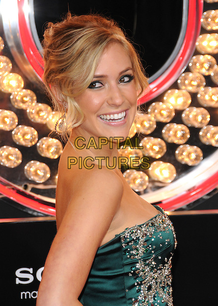 KRISTIN CAVALLARI.'Burlesque' Los Angeles Premiere held at The Grauman Chinese Theatre, Hollywood, CA, USA. .November 15th, 2010 .portrait headshot hair up make-up green strapless gold beaded bustier silk satin jewel encrusted embellished earrings side.CAP/RKE/DVS.©DVS/RockinExposures/Capital Pictures.
