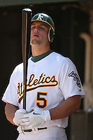 OAKLAND, CA - APRIL 11:  Matt Holliday of the Oakland Athletics stands in the dugout during the game against the Seattle Mariners at the Oakland-Alameda County Coliseum in Oakland, California on Saturday, April 11, 2009.  The Mariners defeated the A's 8-5.  Photo by Brad Mangin