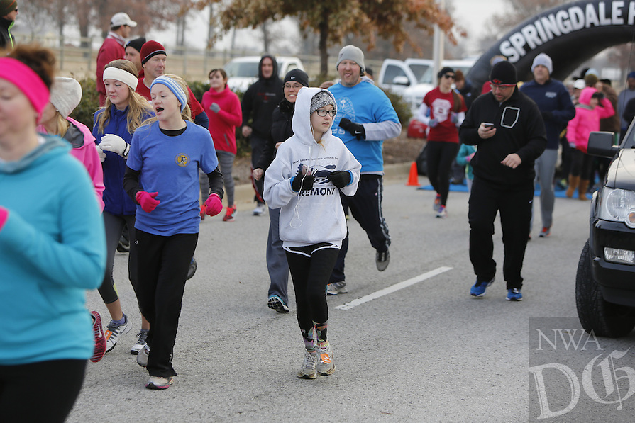 NWA Media/DAVID GOTTSCHALK - 11/27/14 - Springdale Turkey Trot 5K Thursday November 27, 2014 at Arvest Ballpark in Springdale. The annual event, that also includes a fun walk, is presented by The Springdale Reddog Club and raises funds for Springdale Youth Football, the Springdale Police Department Shop-with-a-Cop program and Springdale High School Bulldog Football. Stephanie Brown, of Springdale, was the overall top finisher of the 5k with a time of 16:46.