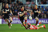 Sam Beard of Edinburgh Rugby loses the ball after being tackled by Bill Meakes of Gloucester Rugby. European Rugby Challenge Cup Final, between Edinburgh Rugby and Gloucester Rugby on May 1, 2015 at the Twickenham Stoop in London, England. Photo by: Patrick Khachfe / Onside Images