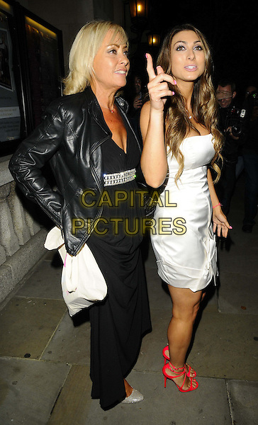 Luisa Zissman &amp; her mother Christina<br /> The Inspiration Awards For Women 2013, Cadogan Hall, Sloane Terrace, London, England.<br /> October 2nd, 2013<br /> full length black white dress mom mum daughter family red strappy sandals shoes leather jacket hand finger pointing <br /> CAP/CAN<br /> &copy;Can Nguyen/Capital Pictures