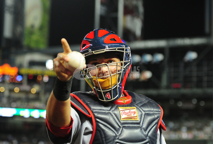 May 8, 2012; Phoenix, AZ, USA; St. Louis Cardinals catcher Yadier Molina reacts as he points into the crowd in the fourth inning against the Arizona Diamondbacks at Chase Field. Mandatory Credit: Mark J. Rebilas-