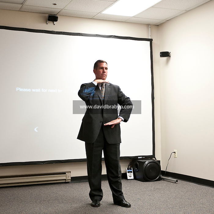 Supervisory Special Agent Richard Schott indicates the area that agents are supposed to aim for when shooting an idividual presenting an iminent threat to life during an explanation of the FBI's lethal force policy at the FBI National Academy in Quantico, VA, USA, 12 May 2009.