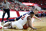 RALEIGH, NC - FEBRUARY 03: NC State's Torin Dorn (2) beats Notre Dame's Rex Pflueger (0) to a loose ball. The North Carolina State Wolfpack hosted the University of Notre Dame Fighting Irish on February 3, 2018 at PNC Arena in Raleigh, NC in a Division I men's college basketball game. NC State won the game 76-58.