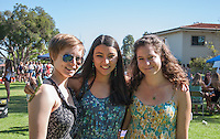 "Emily Linebarger '16, Anisha Banerjee '17, and Dana Stopler '17 enjoy Spring Fest 2015 Pre-show activities on Stewie Beach. The event included food trucks, a bounce house, a beer garden, live entertainment from the band ""Dinner"", and more. (Photo by Nick Harrington, Occidental College Class of 2017)"