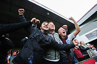 Peterborough United fans celebrate their sides second goal, scored by Matthew Godden<br /> <br /> Photographer Chris Vaughan/CameraSport<br /> <br /> The EFL Sky Bet League One - Scunthorpe United v Peterborough United - Saturday 13th October 2018 - Glanford Park - Scunthorpe<br /> <br /> World Copyright © 2018 CameraSport. All rights reserved. 43 Linden Ave. Countesthorpe. Leicester. England. LE8 5PG - Tel: +44 (0) 116 277 4147 - admin@camerasport.com - www.camerasport.com