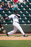 Keon Barnum (20) of the Winston-Salem Dash follows through on his swing against the Carolina Mudcats at BB&T Ballpark on April 22, 2015 in Winston-Salem, North Carolina.  The Dash defeated the Mudcats 4-2..  (Brian Westerholt/Four Seam Images)