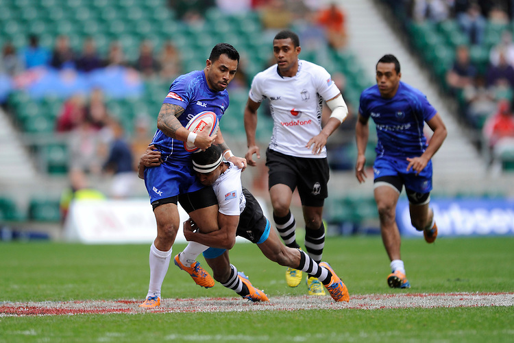 Fautua Otto of Samoa is tackled by Apisai Domolailai of Fiji during Day Two of the iRB Marriott London Sevens at Twickenham on Sunday 11th May 2014 (Photo by Rob Munro)