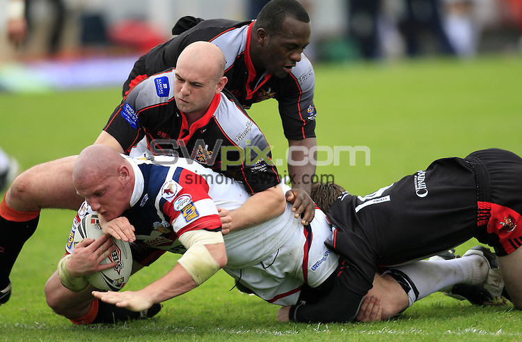 Pix: Chris Mangnall/SWpix.com, Rugby League, Carnegie Challenge Quarter Final. 01/06/08.  Wakefield Wildcats v Oldham Roughyeds....picture copyright>>Simon Wilkinson>>07811267 706>>....Wakefield's Richard Moore tackled by Oldham's Neil Roden Phil Joseph and Matty Brooks