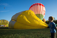 Participants prepare for takeoff during the Velence Lake International Balloon Festival in Agard, Hungary on September 07, 2012. ATTILA VOLGYI
