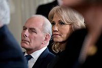 Kellyanne Conway, senior advisor to U.S. President Donald Trump, and John Kelly, White House chief of staff, left, listen during a news conference with U.S. President Donald Trump and Stefan Lofven, Sweden's prime minister, not pictured, in the East Room of the White House in Washington, D.C., U.S., on Tuesday, March 6, 2018. Trump and Lofven are looking to focus on trade and investment between the two countries and ways to achieve shared defense goals. <br /> CAP/MPI/RS<br /> &copy;RS/MPI/Capital Pictures