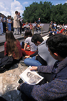 APR 2002, ARGOSTOLI (Cefalonia): studente italiano con la foto di un parente disperso a Cefalonia.APR 2002, ARGOSTOLI (Cephalonia): Italian student with a photo of a missing relative in Cephalonia.