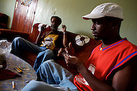 "J. 23 years old, the son of Papa P., a Jamaican Rastafarian, prominent member of the Rasta organization ""Twelve tribes of Israel"" prepares a marijuana cigarette in his  house in Shashamane, a village that hosts more than 300 Rastafarians Families, in Ethiopia on Sunday March 23 2008.///..The Rastafarians, who are mainly from Jamaica, started migrating to Ethiopia 45 years ago, when Haile Selassie, whom they consider to be God incarnate, gave them 500 hectares of land on which to settle..Since the first 12 Jamaican settlers in 1963, the community has grown to over 200 families..The Rastafarian community insists that a mass exodus of Jamaicans to Ethiopia would not be a burden, despite the poverty and economic difficulties faced in the country..Some of them are skilled tradesmen such as carpenters and builders..Others are shop owners and they say that over the decades they have played an important role in the development of Shashamene..In January 2005 there were reports in the media that Bob marley's remains were to be exhumed and then reburied at Shashamane. His wife Rita Marley described Ethiopia as his spiritual home, provoking controversy in Jamaica, where his remains lie..At the beginning of the following month, thousands of fans gathered in Shashamane for a month of celebrations for what would have been Marley's 60th birthday. Until 2005 his birthday celebrations were always held in Jamaica. These events brought Shashamane to wider prominence throughout the world..NAMES OF SUBJECTS CONSUMING ILLEGAL SUBSTANCES  HAVE BEEN FICTIONALIZED OR INITIALED TO PROTECT THEIR IDENTITY."