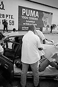 Culiacan, Mexico<br /> June 13, 2007<br /> <br /> A drug related execution, adding to the more then 300 this year in Cuilacan. Felipe Rodr&iacute;guez Peraza, 35, found on the road to Navolato with four bullet wounds inside of his car.  He was the DJ at a table dance club called Osiris. There had been two other guys from table dancing clubs killed in the last four days, this being the 3rd one.