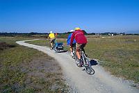 Family cycling on Gravel Path, Boundary Bay Regional Park, Delta, BC, British Columbia, Canada