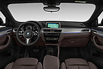 Stock photo of straight dashboard view of a 2018 BMW X2 M Sport X 5 Door SUV
