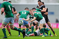 Stephen Kerins of Ireland U20 passes the ball. World Rugby U20 Championship match between New Zealand U20 and Ireland U20 on June 11, 2016 at the Manchester City Academy Stadium in Manchester, England. Photo by: Patrick Khachfe / Onside Images