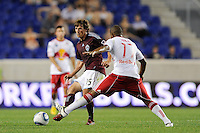Wells Thompson (15) of the Colorado Rapids passes away from Jeremy Hall (17) of the New York Red Bulls. The New York Red Bulls defeated the Colorado Rapids 3-0 during a U. S. Open qualifier match at Red Bull Arena in Harrison, NJ, on May 26, 2010.