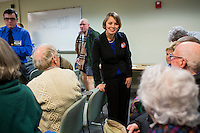 Shenna Bellows, Democratic candidate in Maine for US Senate, speaks people after speaking to the Kittery Democrats town caucus in the Town Hall Council Chambers in Kittery, Maine, USA, on March 3, 2014. Bellows is trying to unseat incumbent Maine Republican Senator Susan Collins in the 2014 election. The town caucus had speeches from various other local candidates and also served to choose delegates for the 2014 Maine State Democratic Caucus.