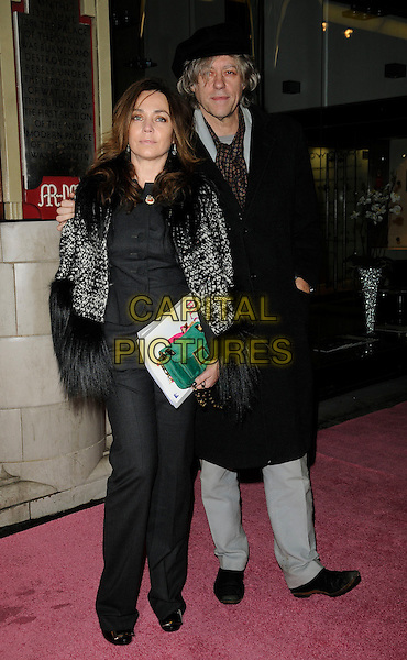 JEANNE MARINE & SIR BOB GELDOF .At the Gala Performance of 'Legally Blonde' the musical at The Savoy Theatre, London, England. .January 13th, 2010..arrivals full length fur trim black coat jacket hat cap coat couple trousers grey gray  .CAP/CAN.©Can Nguyen/Capital Pictures