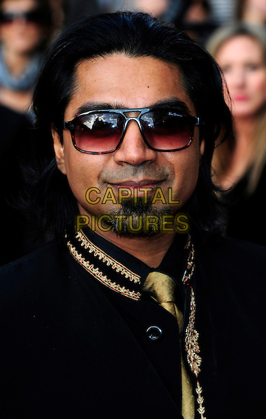 ARVIND ETHAN DAVID .Attending the World premiere gala screening of 'The Infidel' held at the Hammersmith Apollo, London, England, UK, April 8th, 2010..arrivals portrait headshot sunglasses black gold tie embroidered shirt beard facial hair goatee.CAP/CJ.©Chris Joseph/Capital Pictures.