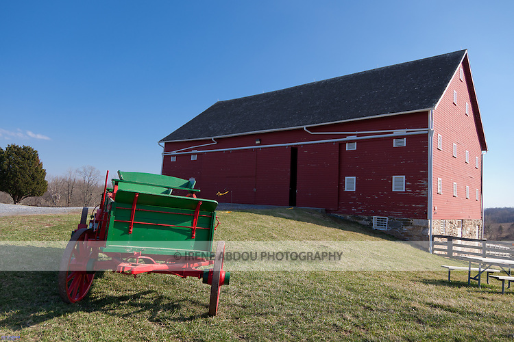 At the Agricultural History Farm Park in Derwood, Maryland, a green and red wagon and old red barn lend an old-time feel to couples seeking a rustic wedding theme.  The Agricultural History Farm Park is a wedding and event venue operated by Montgomery County Parks.