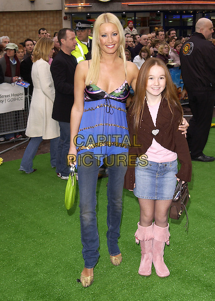 "DENISE VAN OUTEN & GODDAUGHTER ALICIA.UK film premiere of ""The Magic Roundabout"", Vue Cinema, Leicester Square, London, January 30th 2004..full length blue black camisole vest top gold stripes skinny jeans .Ref: DH.www.capitalpictures.com.sales@capitalpictures.com.©David Hitchens/Capital Pictures ."